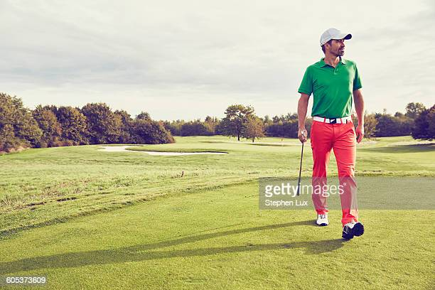 golfer walking on course, korschenbroich, dusseldorf, germany - golfer stock pictures, royalty-free photos & images