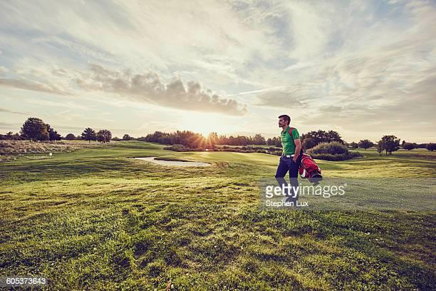 Golfer walking on course, Korschenbroich, Dusseldorf, Germany
