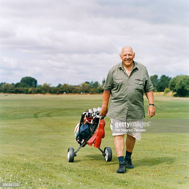 A golfer walks on a golf course
