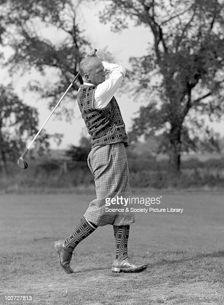 Golfer wearing plus fours United Kingdom c1930s Golfer wearing plus fours concentrating on his ball after striking it off the fairway c 1930s