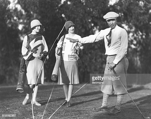 Golfer Will Armour with two female caddies 1925