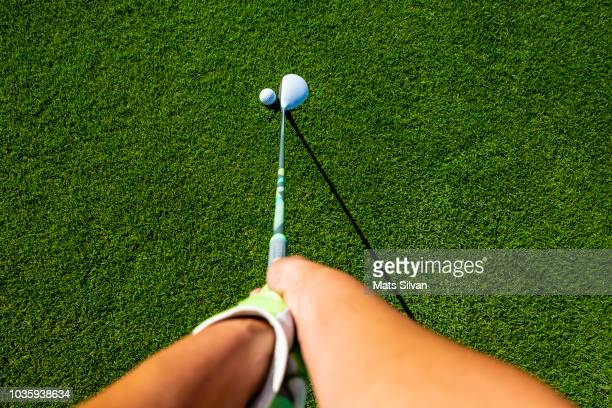 golfer with golf club fairway wood and golf ball - driver golf club stock pictures, royalty-free photos & images