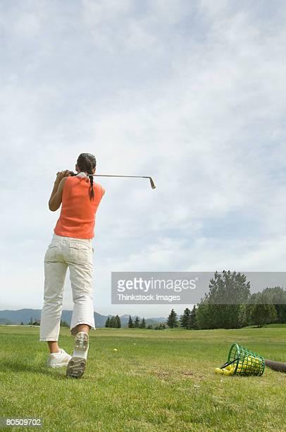 Golfer with golf club