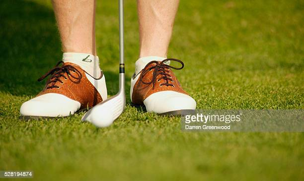Golfer With Shoes and Club