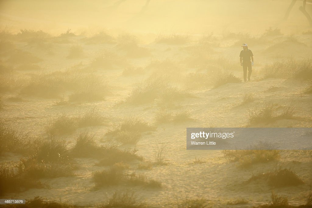 A golfer wonders around the sand looking for his ball during the pro-am as a preview for the 2014 Omega Dersert Classic on the Majlis Course at the Emirates Golf Club on January 29, 2014 in Dubai, United Arab Emirates.