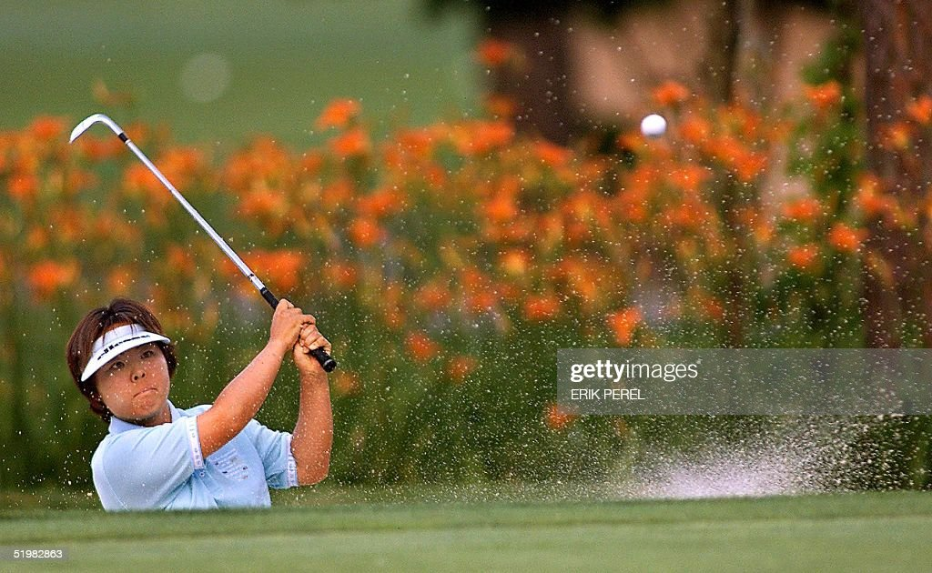 Golfer Yuri Fudoh of Japan blasts out of a sand tr : News Photo