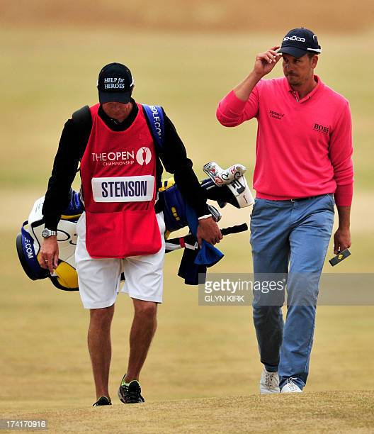 US golfer Zach Johnson acknowledges the crowd as he walks towards the 18th green during the fourth and final round of the 2013 British Open Golf...