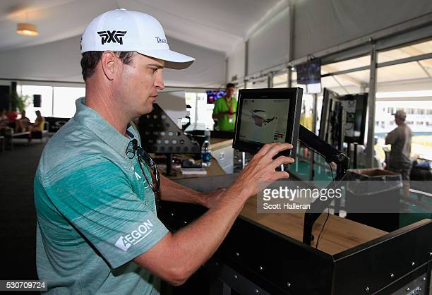 Golfer Zach Johnson designs a pair of Oakley sunglasses inside the Oakley suite during a practice round prior to the start of THE PLAYERS...