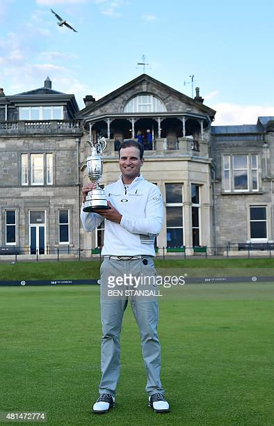 US golfer Zach Johnson holds up the Claret Jug the trophy for the Champion golfer of the year in front of the clubhouse as his poses for a photograph...