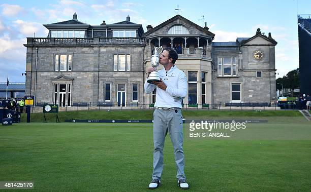 US golfer Zach Johnson kisses the Claret Jug the trophy for the Champion golfer of the year in front of the clubhouse as his poses for a photograph...