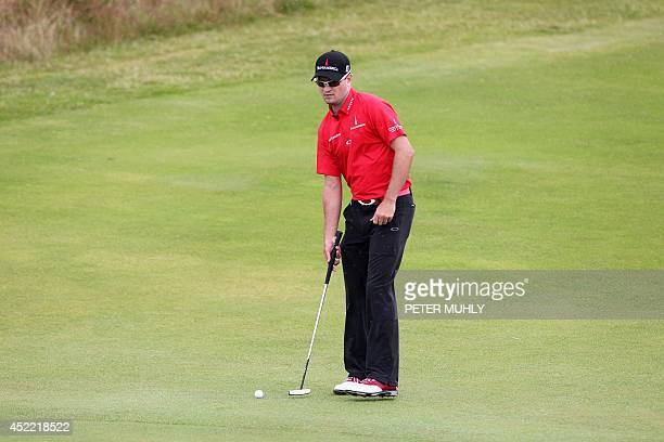 US golfer Zach Johnson lines up a putt on the 3rd green during a practice round at Royal Liverpool Golf Course in Hoylake north west England on July...