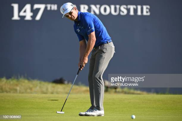 US golfer Zach Johnson makes a birdie putt on the 18th green during his first round on day one of The 147th Open golf Championship at Carnoustie...