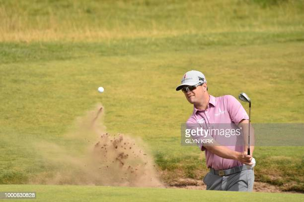 US golfer Zach Johnson plays out of a greenside bunker on the 6th hole during a practice round at The 147th Open golf Championship at Carnoustie...