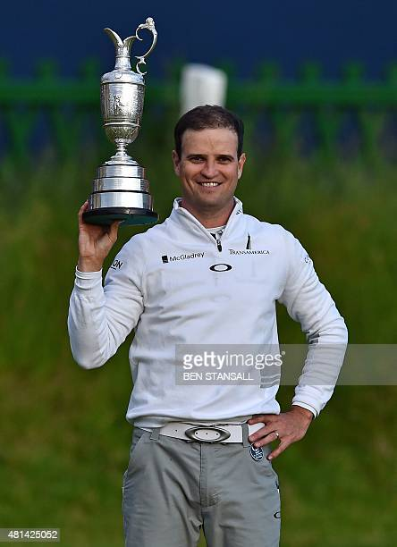 US golfer Zach Johnson poses for a photograph with the Claret Jug the trophy for the Champion golfer of the year as his poses for a photograph after...