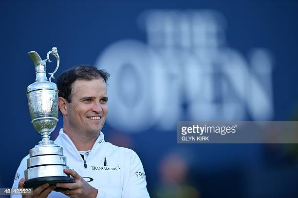 US golfer Zach Johnson poses for a photograph with the Claret Jug the trophy for the Champion golfer of the year after winning the threeway playoff...