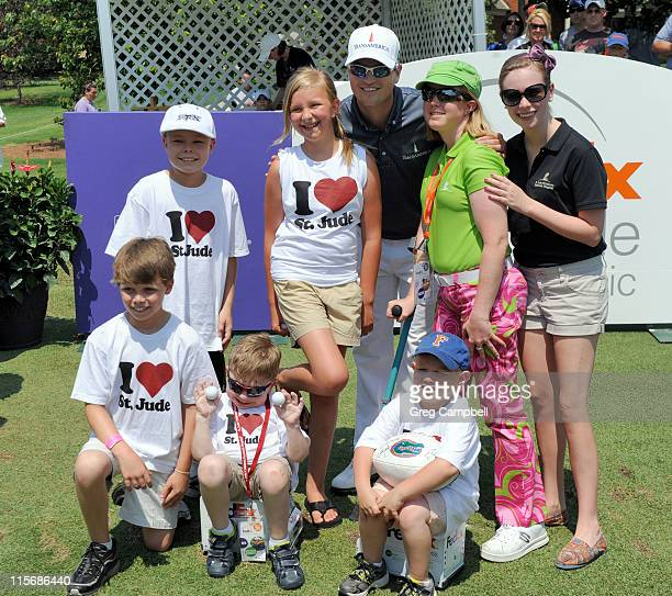 PGA golfer Zach Johnson poses with St Jude patients at TPC Southwind on June 8 2011 in Memphis Tennessee