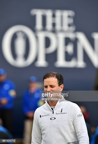 US golfer Zach Johnson reacts as he goes to collect his trophy after winning the threeway playoff on day five of the 2015 British Open Golf...
