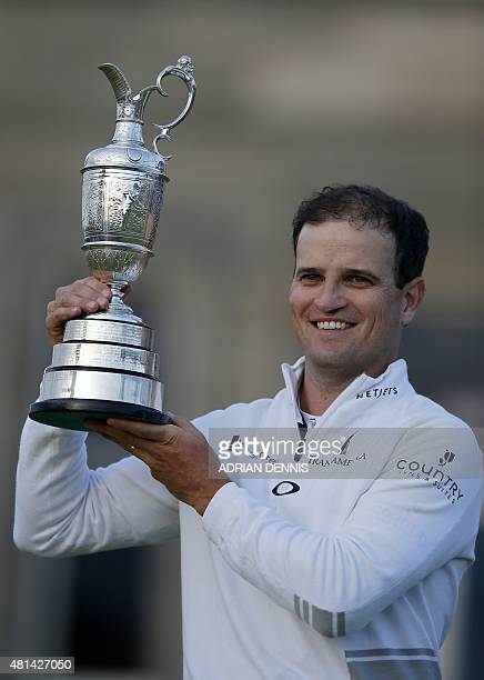 US golfer Zach Johnson smiles as he poses for a photograph with the Claret Jug the trophy for the Champion golfer of the year after winning the...