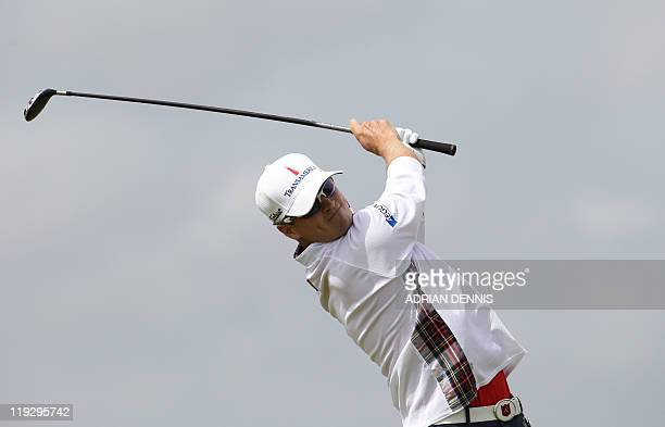 US golfer Zach Johnson tees off from the 3rd Tee on the final day of the 140th British Open Golf championship at Royal St George's in Sandwich Kent...