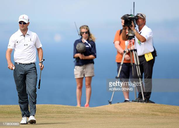 US golfer Zach Johnson walks on the 11th green during the first round of the 2013 British Open Golf Championship at Muirfield golf course at Gullane...