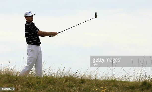 US golfer Zach Johnson watches his drive on the 7th tee on the first day of the 138th British Open Championship at Turnberry Golf Course in south...