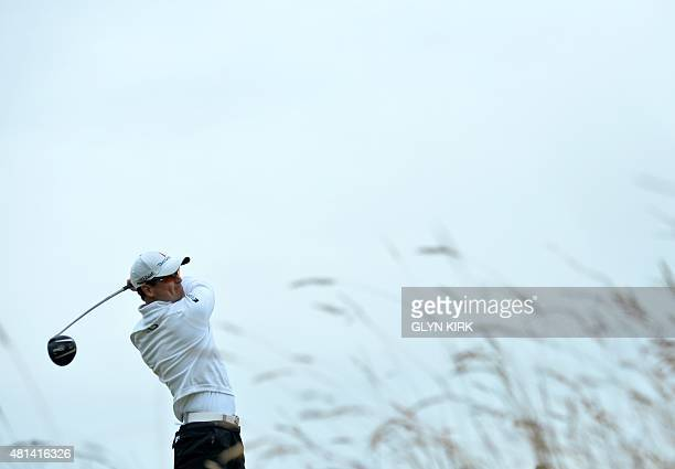 US golfer Zach Johnson watches his shot from the 16th tee during his final round 66 on day five of the 2015 British Open Golf Championship on The Old...