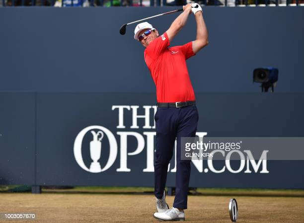 US golfer Zach Johnson watches his shot from the 1st tee during his third round on day 3 of The 147th Open golf Championship at Carnoustie Scotland...