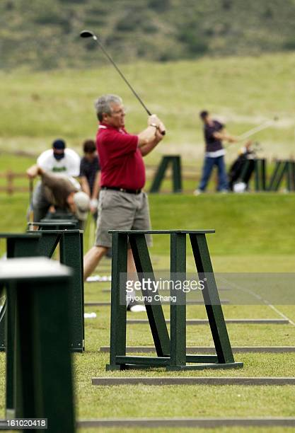 Golfers are in practice at the driving range of Meadows Golf Course on Saturday afternoon. Five people were injured by a lightning strike at the Golf...