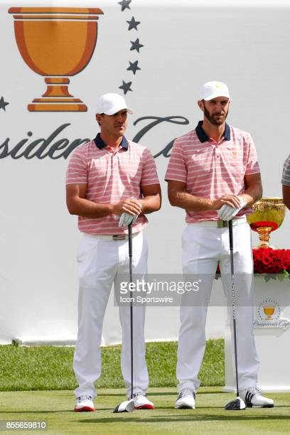 USA golfers Brooks Koepka and Dustin Johnson wait to tee off on the first hole during the second round of the Presidents Cup at Liberty National Golf...