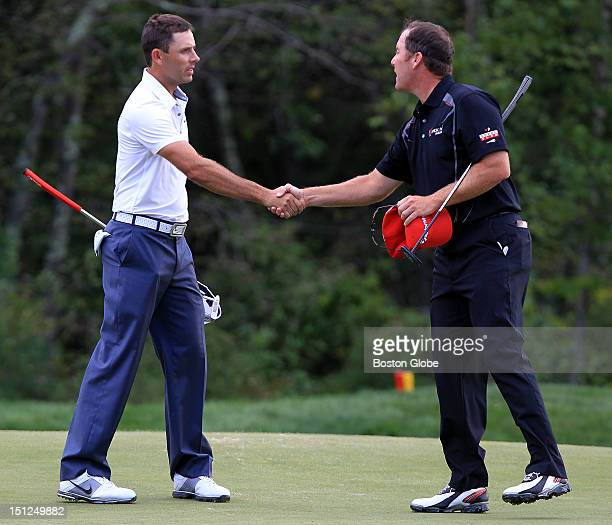 Golfers Charles Schwartzel, left, and D.A. Points shake hands after finishing their day on the 18th green during the during the Second Round of the...
