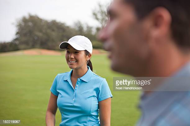 golfers conversing on the green - baseball cap stock pictures, royalty-free photos & images