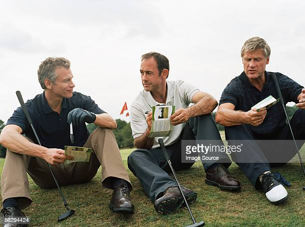 golfers discussing scores - scoring stock pictures, royalty-free photos & images
