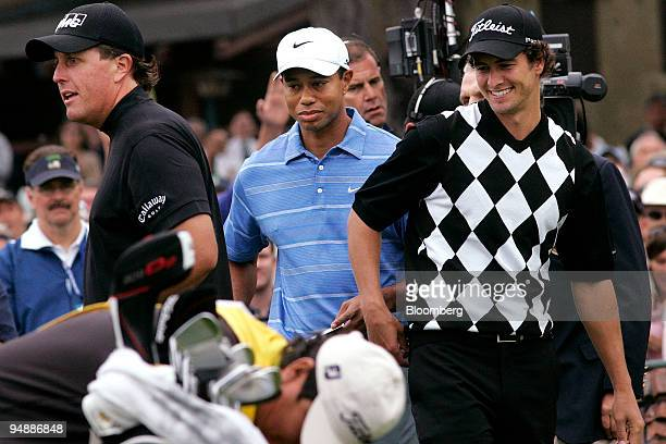 Golfers from left Phil Mickelson Tiger Woods and Adam Scott chat before the start of day one of the 108th US Open at Torrey Pines Golf Course in La...