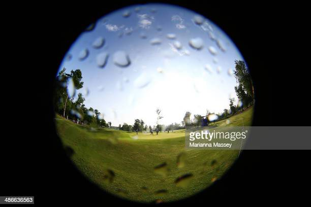 Golfers from the group of Lucas Glover, Jonathan Byrd and Scott Verplank putt on the first green during Round Two of the Zurich Classic of New...