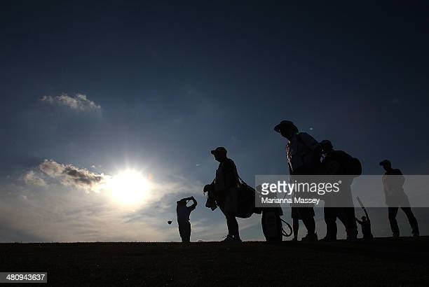 Golfers from the group Woody Austin Johnson Wagner and Harrison Frazar tee off on the 11th during Round One of the Valero Texas Open at the ATT Oaks...