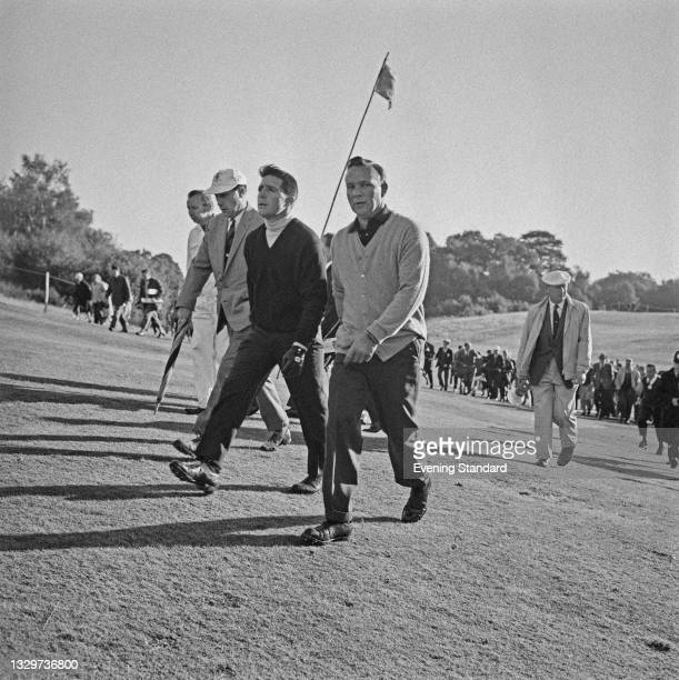 Golfers Gary Player and Arnold Palmer compete in the 1964 Piccadilly World Match Play Championship at Wentworth, UK, 10th October 1964.