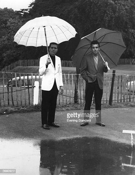 Golfers Gary Player and Tony Jacklin look disappointedly at the rain, which stopped play at Wentworth in Surrey.