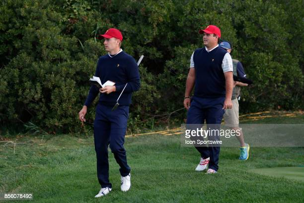 USA golfers Jordan Spieth and Patrick Reed walk the 5th hole during the third round of the Presidents Cup at Liberty National Golf Club on September...
