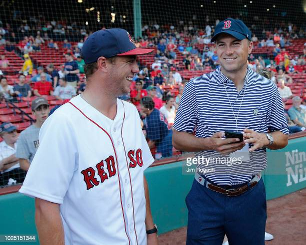 Golfers Justin Thomas and Jordan Spieth chat at Fenway Park before a game between the Boston Red Sox and the Miami Marlins on August 29, 2018 in...
