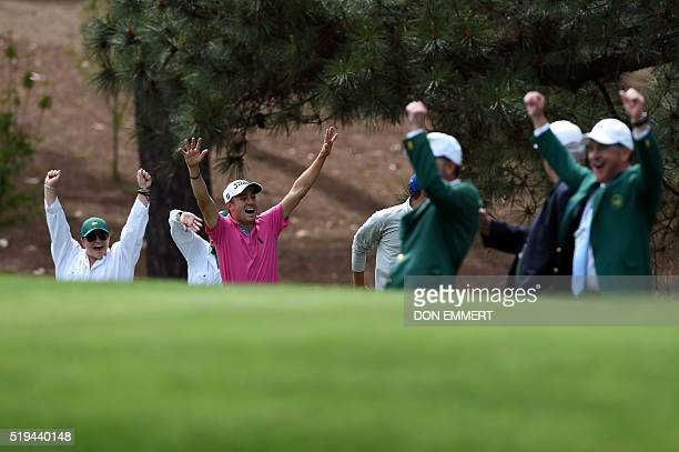 US golfers Justin Thomas celebrates after he and Rickie Fowler celebrate after both made a holeinone at the 4th during the Par 3 contest prior to the...