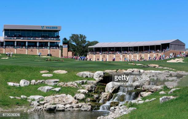 Golfers make their way up the 18th fairway during the final round of the Valero Texas Open at TPC San Antonio ATT Oaks Course on April 23 2017 in San...