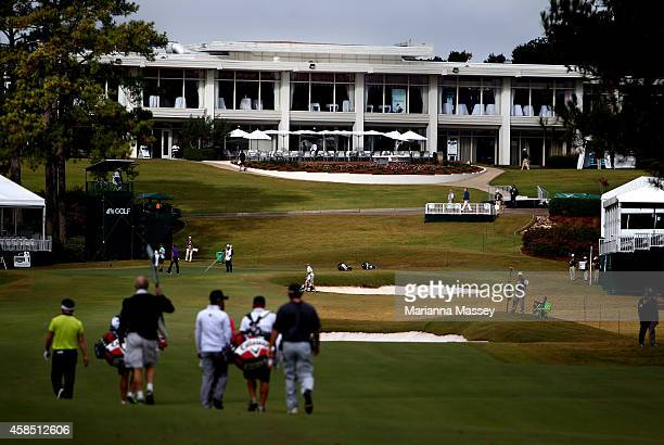 Golfers make their way up the ninth fairway toward the clubhouse during round one of the Sanderson Farms Championship at The Country Club of Jackson...
