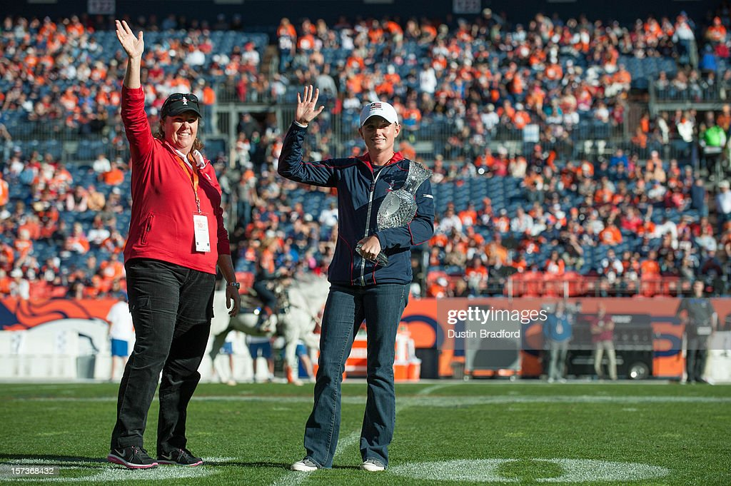 Golfers Meg Mallon and Stacy Lewis represent the 2013 Solheim Cup prior to a game between the Denver Broncos and the Tampa Bay Buccaneers at Sports Authority Field Field at Mile High on December 2, 2012 in Denver, Colorado.