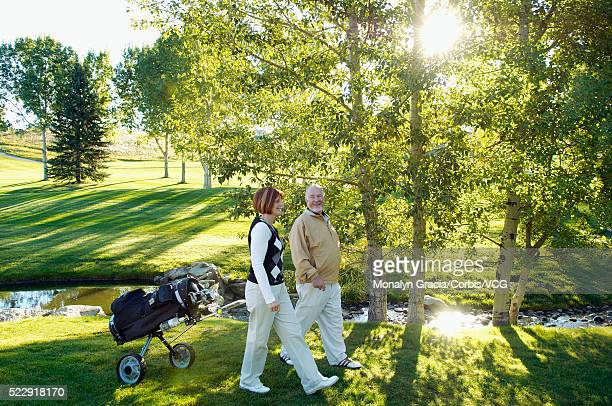 Golfers on beautiful woodland golf course
