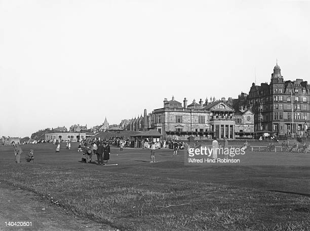 Golfers on the Embankment putting greens at the Royal and Ancient Golf Club of St Andrews, circa 1925. Scotland, the clubhouse is on the right.