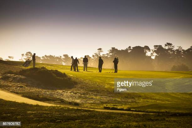 golfers on the putting green in pebble beach california usa - pebble beach california stock pictures, royalty-free photos & images