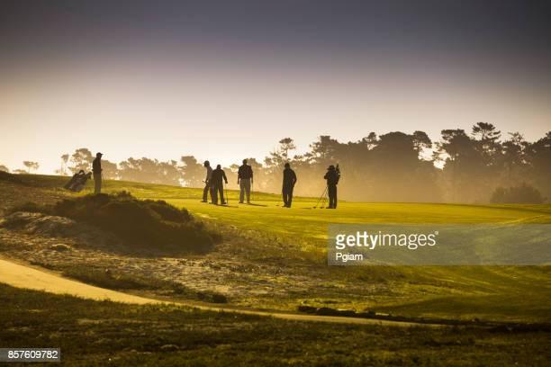 Golfers on the putting green in Pebble Beach California USA