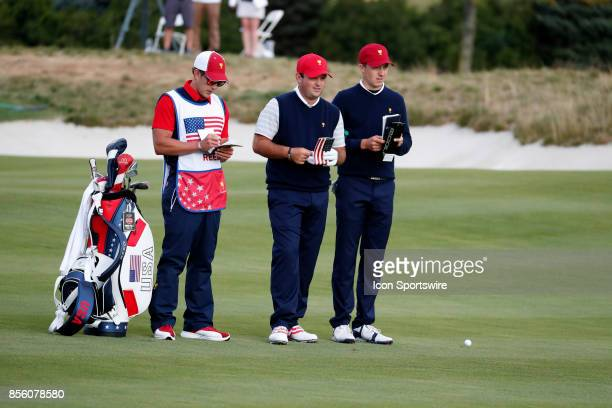 USA golfers Patrick Reed and Jordan Spieth look at their yardage books on the 6th hole during the third round of the Presidents Cup at Liberty...
