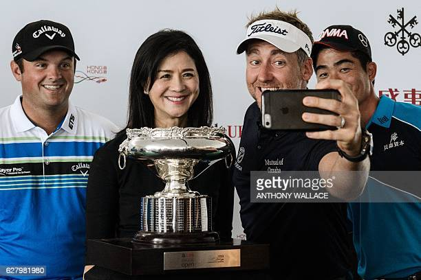 Golfers Patrick Reed of the US Ian Poulter of Britain and Liang Wenchong of China pose in front of the Hong Kong Open golf tournament trophy after a...