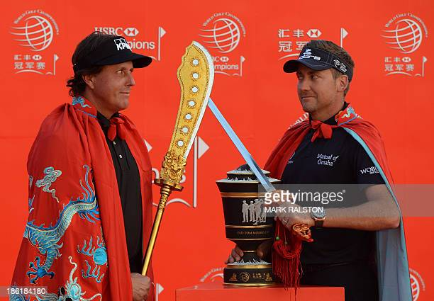 Golfers Phil Mickelson of the US and defending WGCHSBC Champion Ian Poulter of England attend the photo call for the WGCHSBC Champions tournament on...